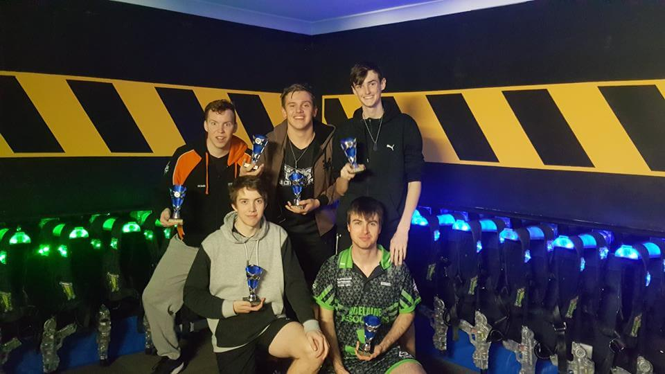 "First Place goes to Adelaide Wolfpack   Back Row, Left to Right: Robin ""BAKURA"" Hunt (Vice Captain), Brendon ""Grub"" Wood, Nick ""Wax"" Risk Front Row, Left to Right: Caleb ""Memeless"" Waller, Tim ""Azrael"" Ellers (Captain) Photo Credit: Emily Elliott"